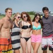 Cast members during a beach scene