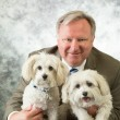 A man who takes his work home with him. Rob Blizard, Norfolk SPCA executive director, with his adoptees Holly and Ginger.