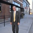 Brother Rutter walks along Granby street outside of the revitalized Texaco Building