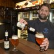 (Kevin Osfolk of Portsmouth's Bier Garden pours a glass of 1516 Kellerbier from Weihenstephaner)