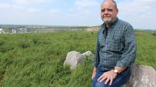 Tom Robotham atop Croft Hill, Leicestershire, which overlooks the granite quarry where his grandfather used to work.