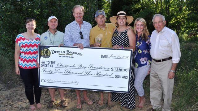 (Members from the Chesapeake Bay Foundation receive a ceremonial check from Devils Backbone Brewing Company)